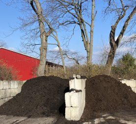 Three piles of mulch